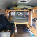 Digital-Nomad-Living-in-a-School-Bus—inside-view-of-stars-and-stripes-bus