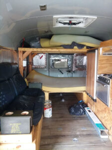 inside view of stars and stripes bus - Digital Nomad Living in a School Bus