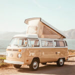 an old vw bus with pop up camper living the vanlife